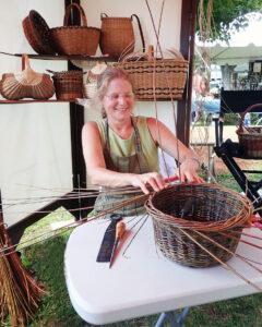 Wendy Jensen working on a willow basket - Photo by Lynn Martin Graton
